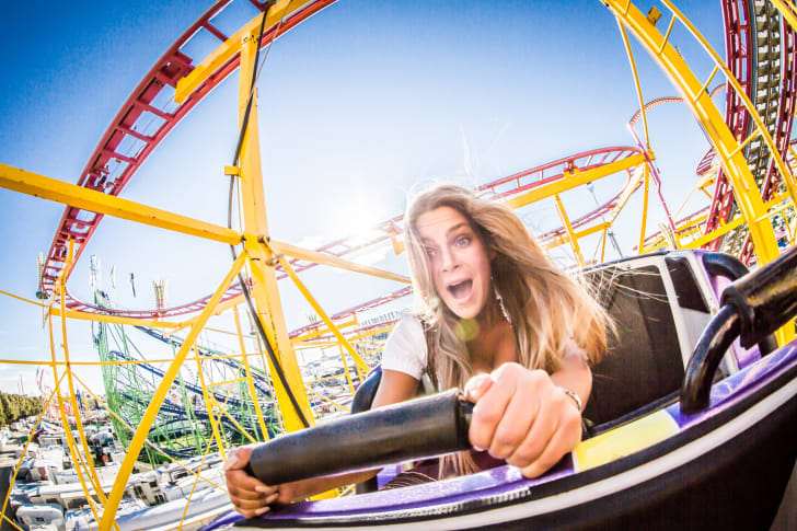 A woman taking a ride on a rollercoaster at Oktoberfest in Munich, Germany