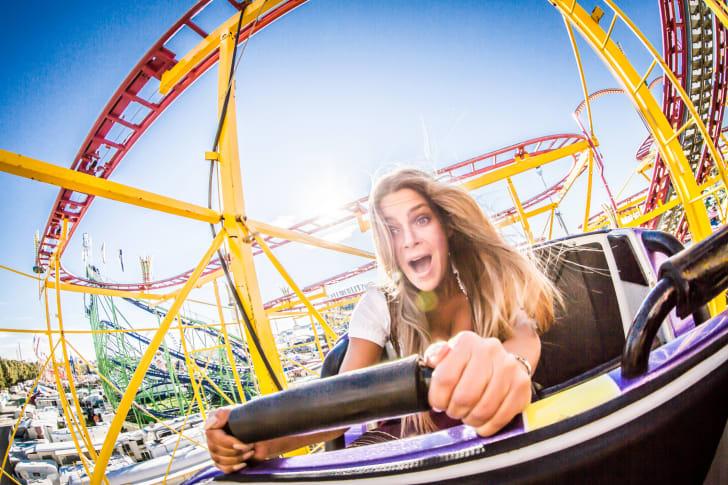 A woman taking a ride on a rollercoaster at Oktoberfest in Munich, Germany