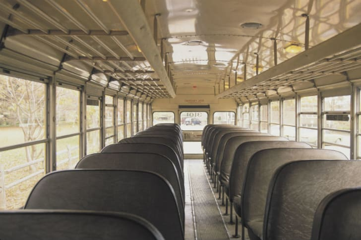The interior of a school bus is pictured