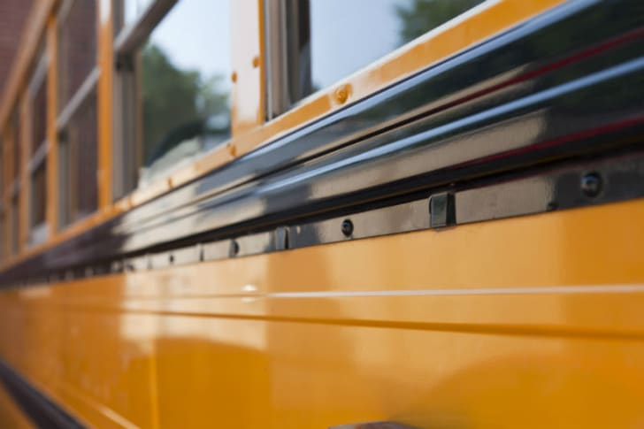 The side of a school bus is pictured