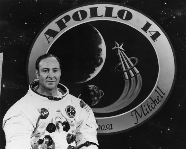November 1970: Apollo 14 Lunar Module Pilot Edgar Mitchell with the Apollo 14 emblem.