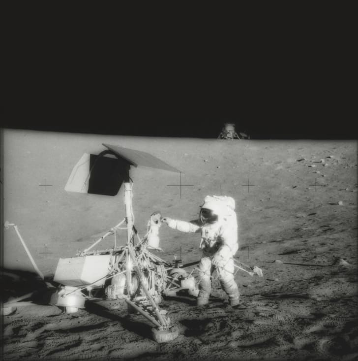 Astronaut Charles 'Pete' Conrad stands next to the Surveyor 3 lunar lander on the Moon, during NASA's Apollo 12 lunar landing mission, November 1969. The unmanned Surveyor 3 landed on the moon in April 1967