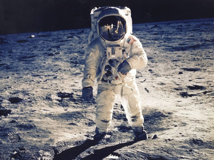 Astronaut Edwin E. Aldrin Jr., Lunar Module Pilot, Is Photographed Walking Near The Lunar Module During The Apollo 11 Extravehicular Activity