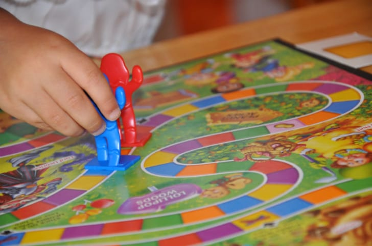 A child playing the board game 'Candy Land' is pictured