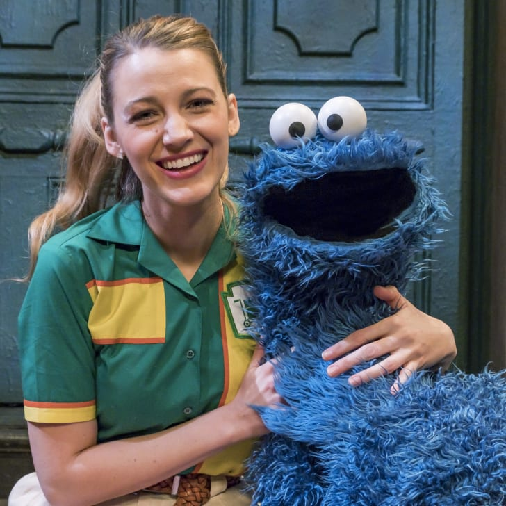 Actress Blake Lively (L) poses with Cookie Monster on the set of 'Sesame Street'