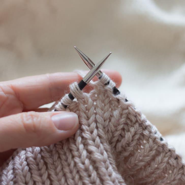 knitting needles and garment