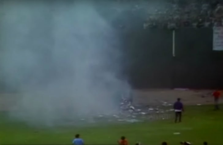 A screen capture from footage of the Disco Demolition Night promotion at Comiskey Field in Chicago, Illinois on July 12, 1979 is pictured
