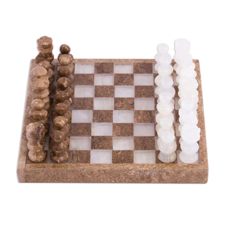 Image of a miniature chess set made out of onyx and marble