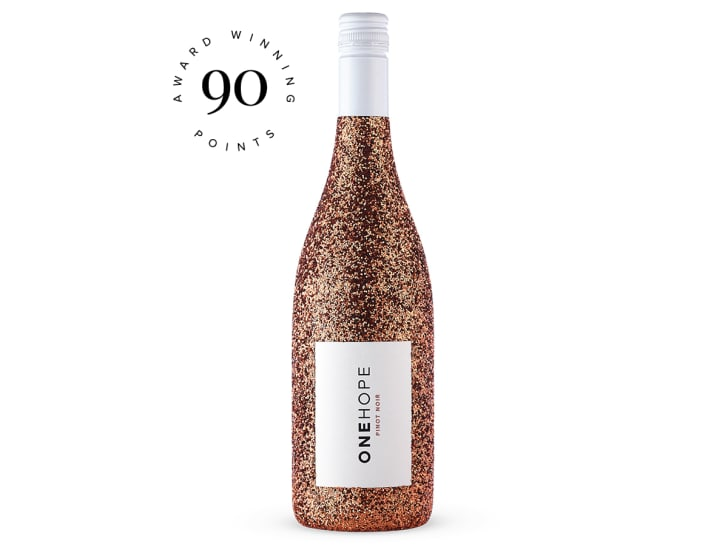 Image of a wine bottle covered in bronze glitter