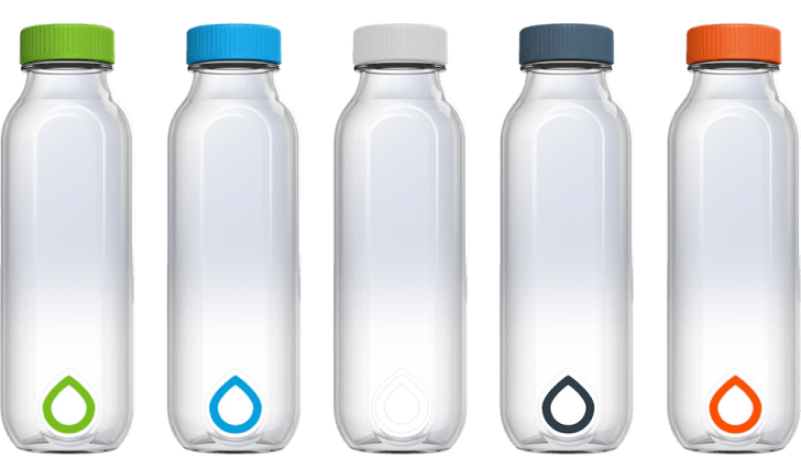 Image of five clear hard plastic water bottles set up in a horizontal line.
