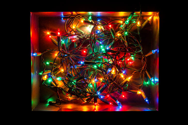 Tangled christmas lights in a box.