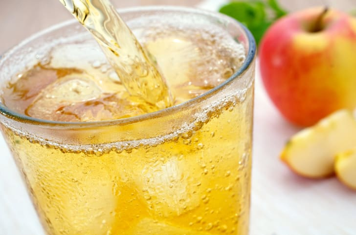 A glass of apple juice spritzer