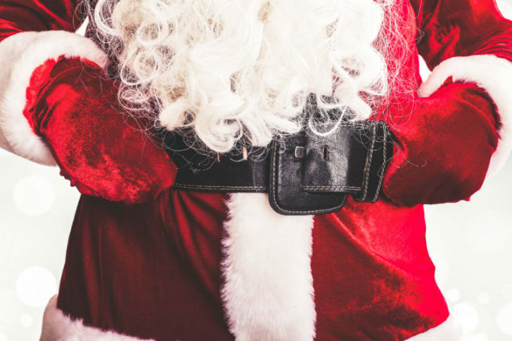 A man dressed as Santa Claus is pictured putting his hands on his belt
