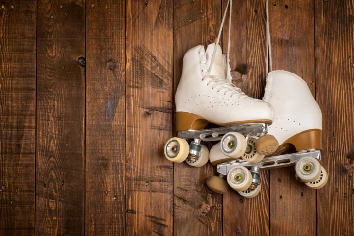 Roller skates on a wooden background