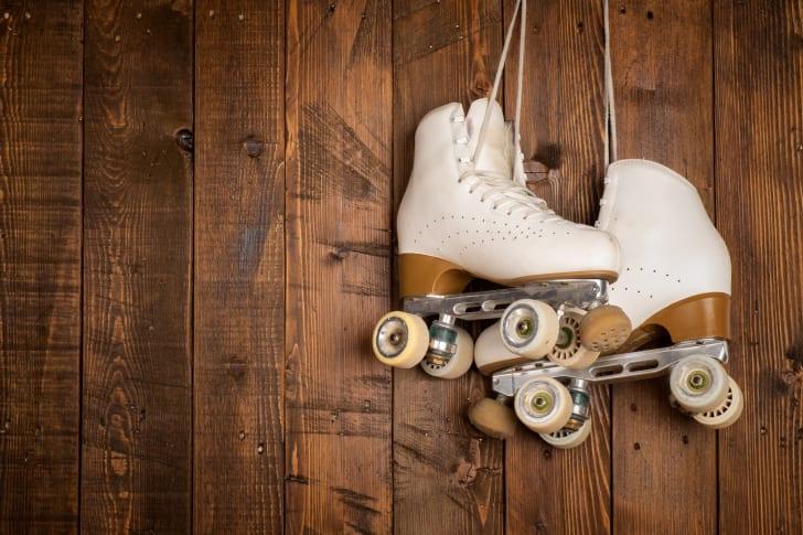 Roller skates on a wooden background