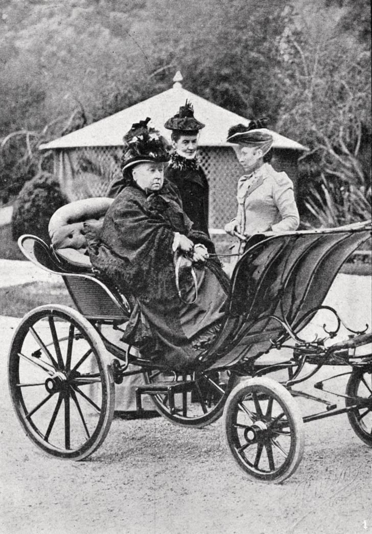 Queen Victoria sitting in a carriage car