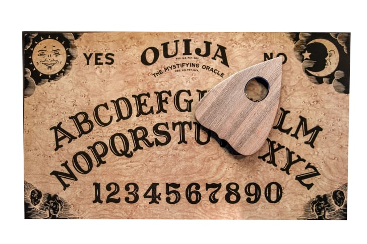A close-up image of a Ouija Board game