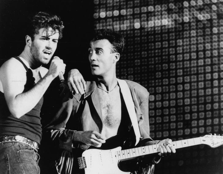 Singers George Michael (left) and Andrew Ridgeley, of the band 'Wham!', performing on stage, July 1986
