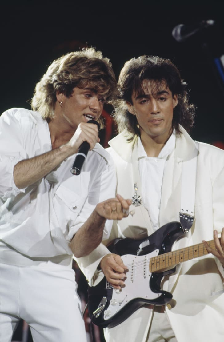 Andrew Ridgeley (right) and George Michael (1963-2016) of Wham! performing on stage together in Sydney, Australia during the pop duo's 1985 world tour, January 1985.