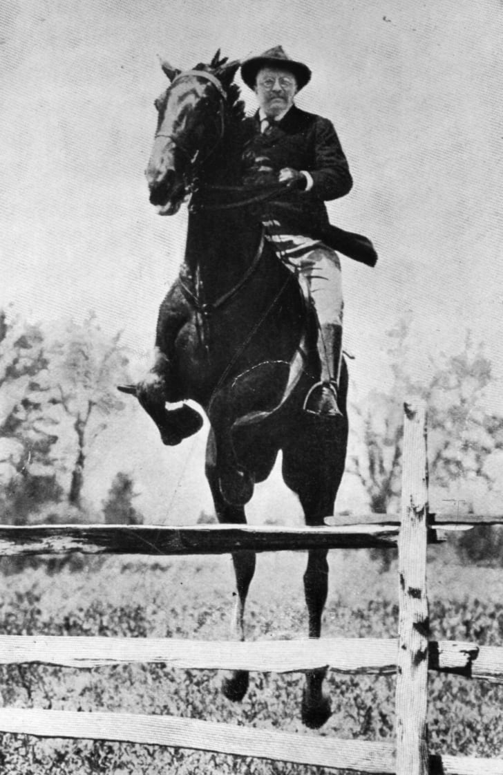 Theodore Roosevelt (1858 - 1919), the 26th President of the United States (1901-09), jumping hurdles at the Chevy Chase club Washington