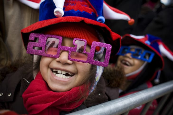 "A girl wears ""2010"" glasses in Times Square on December 31, 2009 in New York City"
