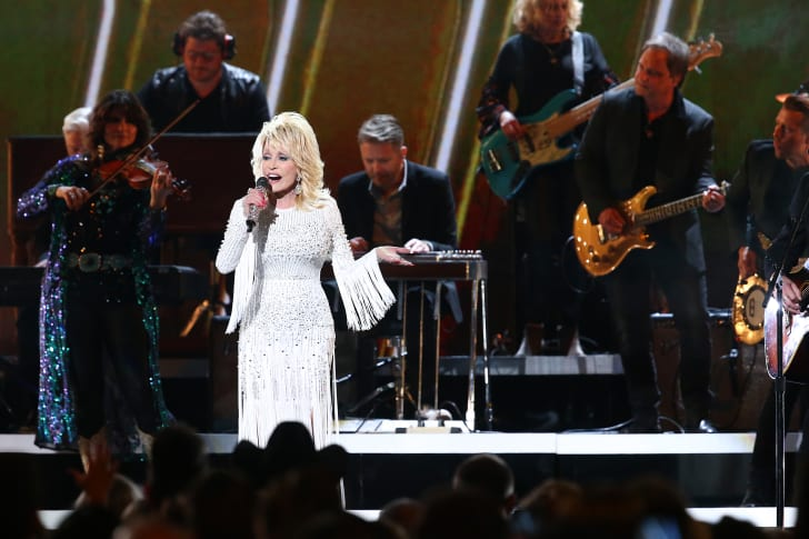 Dolly Parton singing on stage.