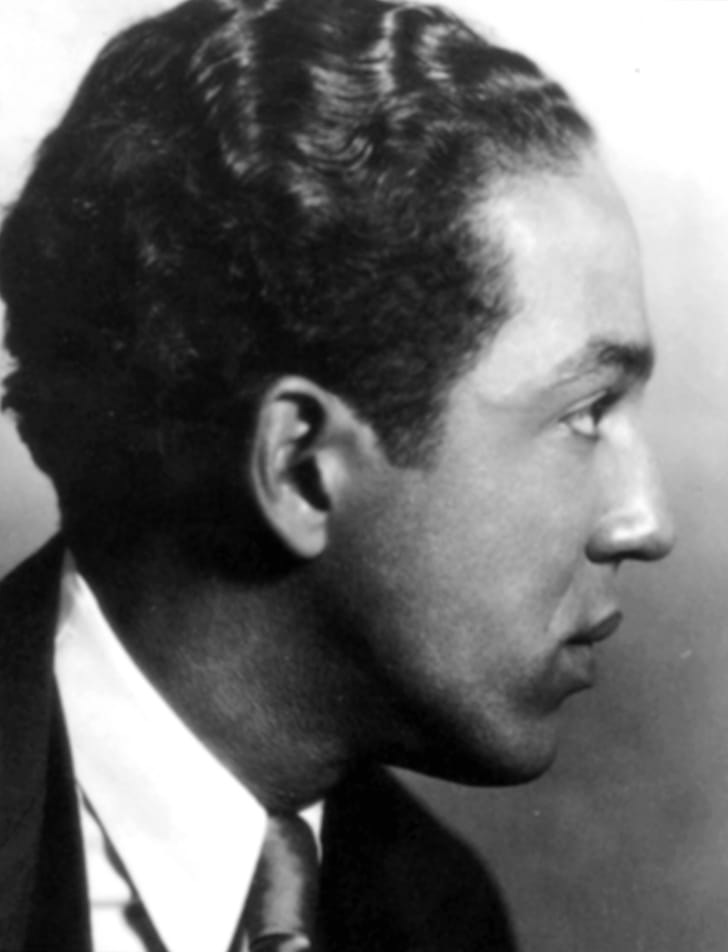 A profile photo of Langston Hughes.