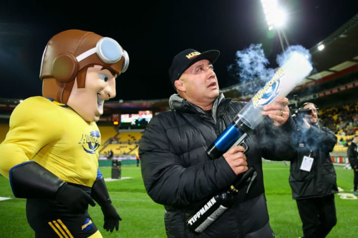 Rugby mascot Captain Hurricane (L) stands near former Hurricanes player Norm Hewitt (R) as he fires a T-shirt cannon at Westpac Stadium in Wellington, New Zealand in May 2018