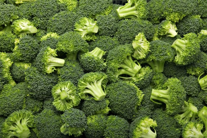 A photo of a pile of broccoli florets