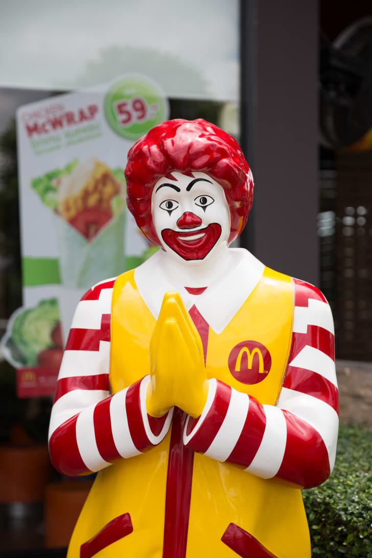 A photo of Ronald McDonald outside of a McDonald's in Thailand