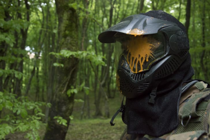 A person playing paintball is pictured