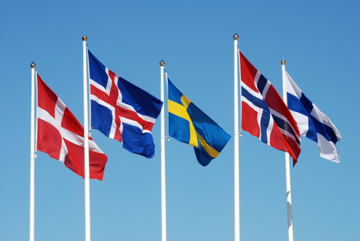 Photo of the Scandinavian flags against a blue sky