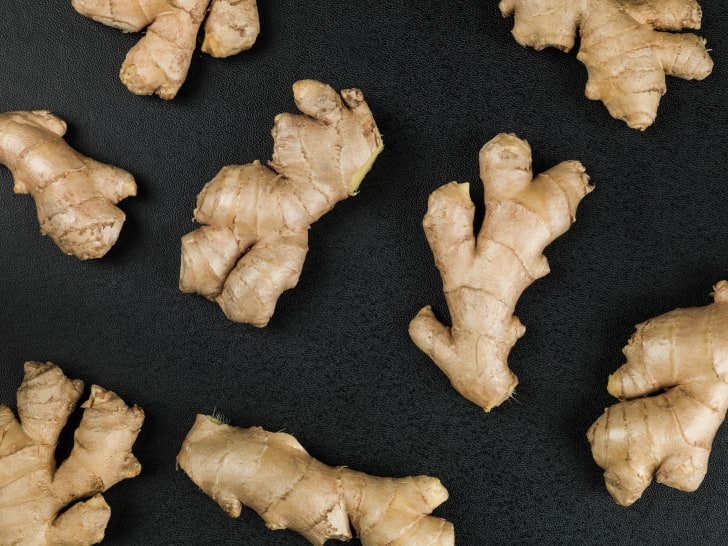 fresh ginger on a black background