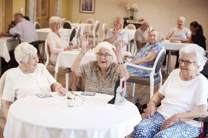 women in a nursing home play bingo