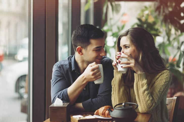 couple sips coffee on a date