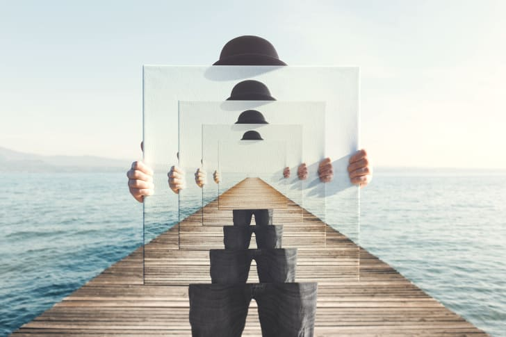 Surreal painting of hands holding canvas featuring the same image repeating