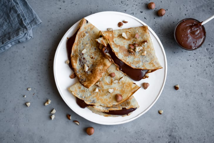 Overhead shot of a plate of Nutella-filled crepes