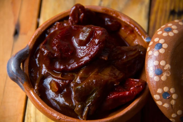 A small bowl of red chipotle peppers