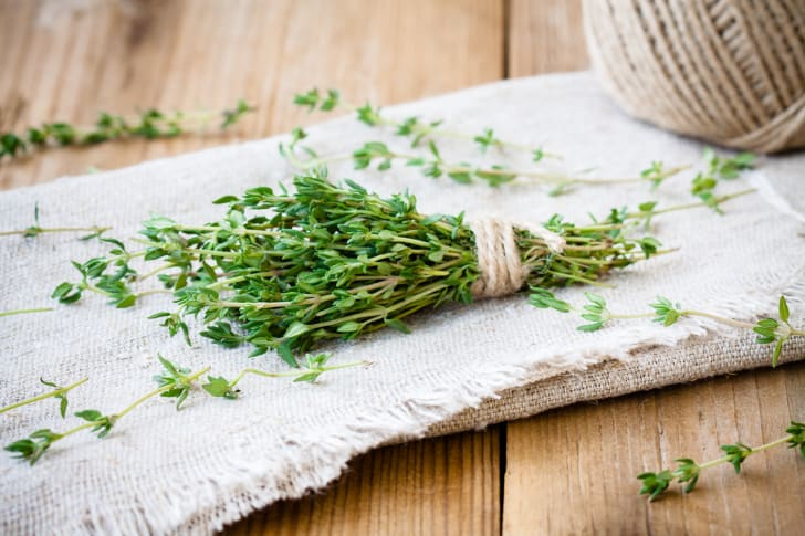 A bundle of thyme on a mat on a table