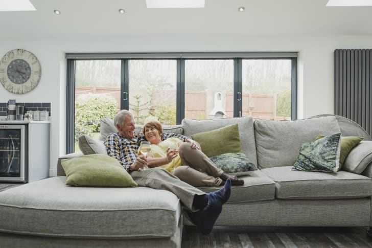 An older couple relaxing on a large sofa