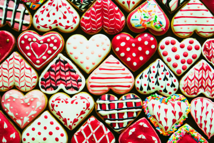 Rows of colorful heart-shaped cookies