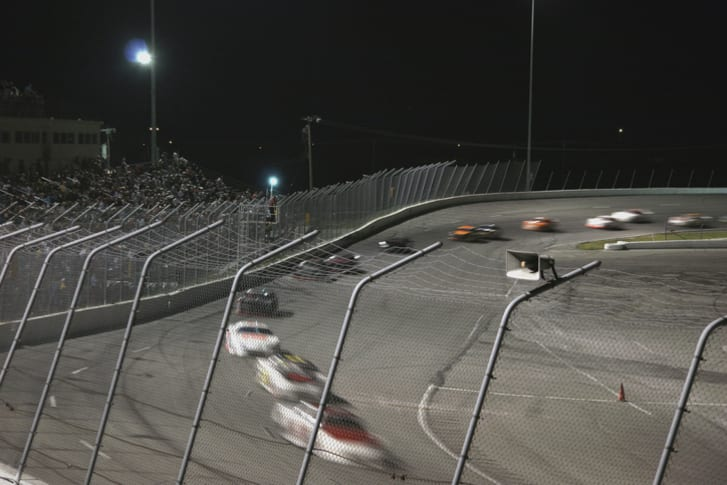Race cars speeding around a track