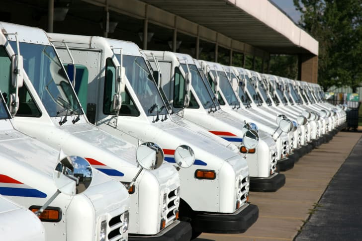 row of parked mail trucks