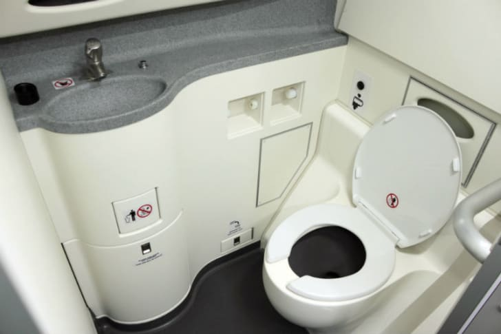 An airplane bathroom is pictured