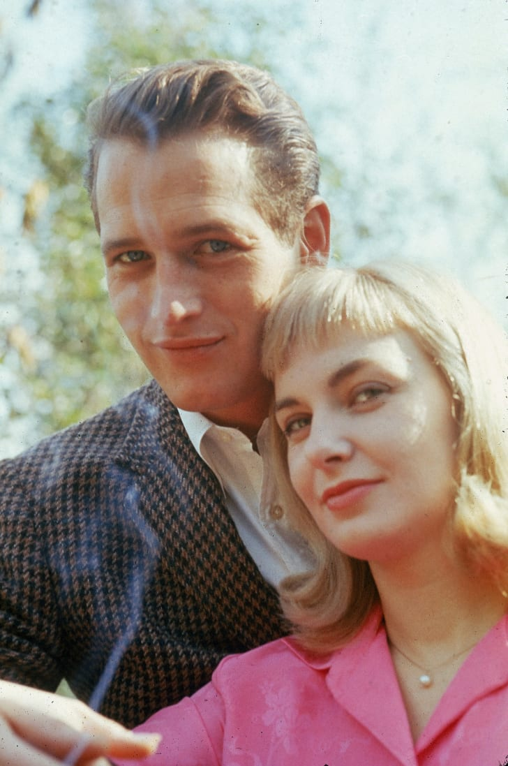 Paul Newman and Joanne Woodward standing outdoors, circa 1962