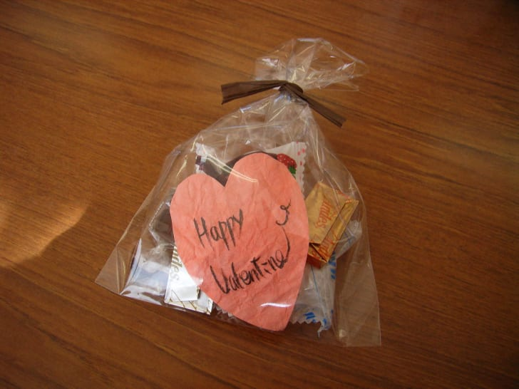 """Women gift chocolate known as """"giri choco"""" to co-workers on Valentine's Day."""