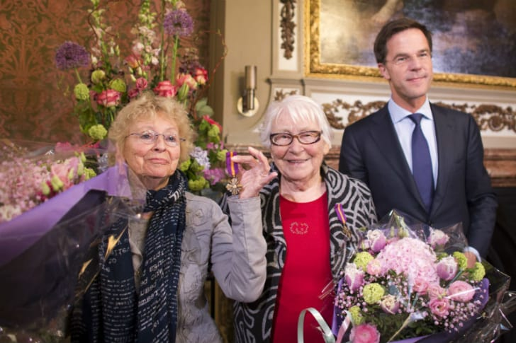 Sisters Freddie Dekker-Oversteegen (L) and Truus Menger-Oversteegen (R) are pictured being awarded the Mobilization War Cross by Dutch Prime Minister Mark Rutte in 2014