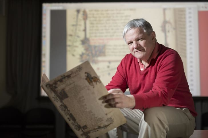 peter robinson pictured with canterbury tales manuscript