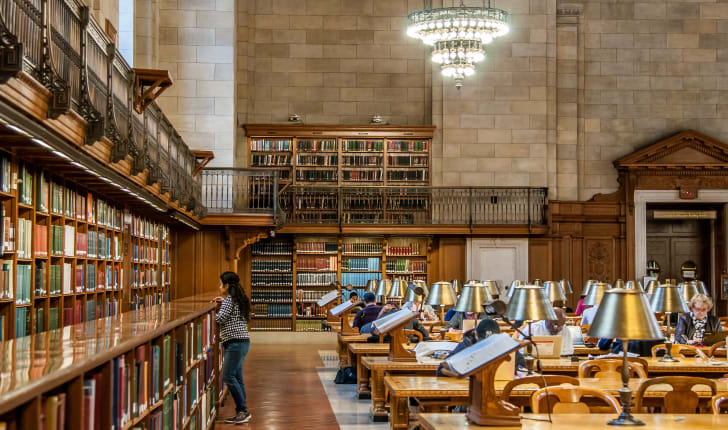 A woman browses the shelves at the New York Public Library.