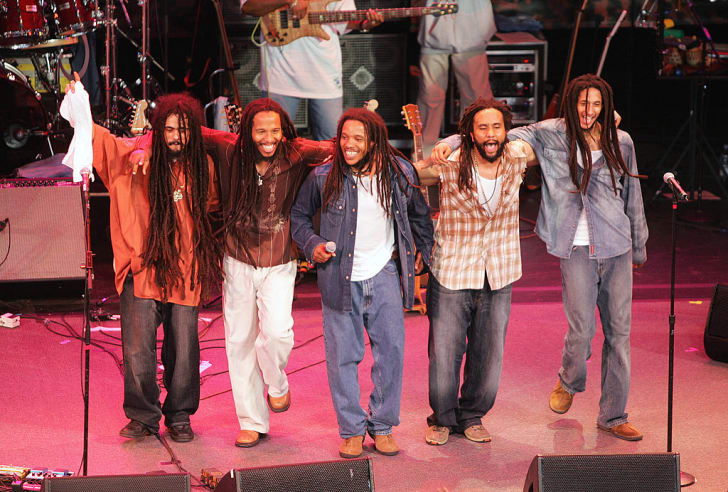 """Damian, Ziggy, Stephen, Kymani and Julian Marley, sons of Bob Marley, perform onstage at the """"Roots, Rock, Reggae Tour 2004"""" in Vienna, Virginia."""